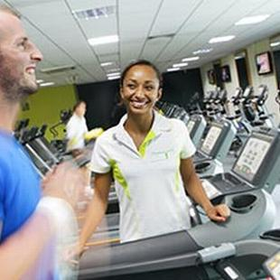 Chichester gym member running on treadmill