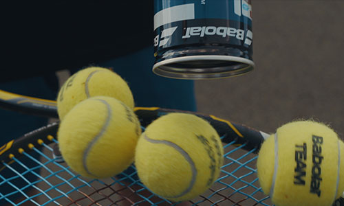 Tennis balls on racket