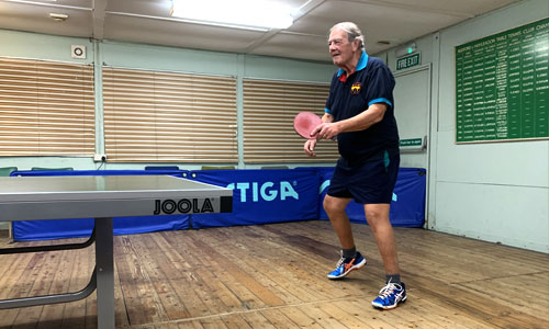 old guy playing table tennis