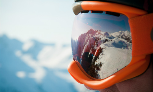 Skiier pondering life at top of mountain