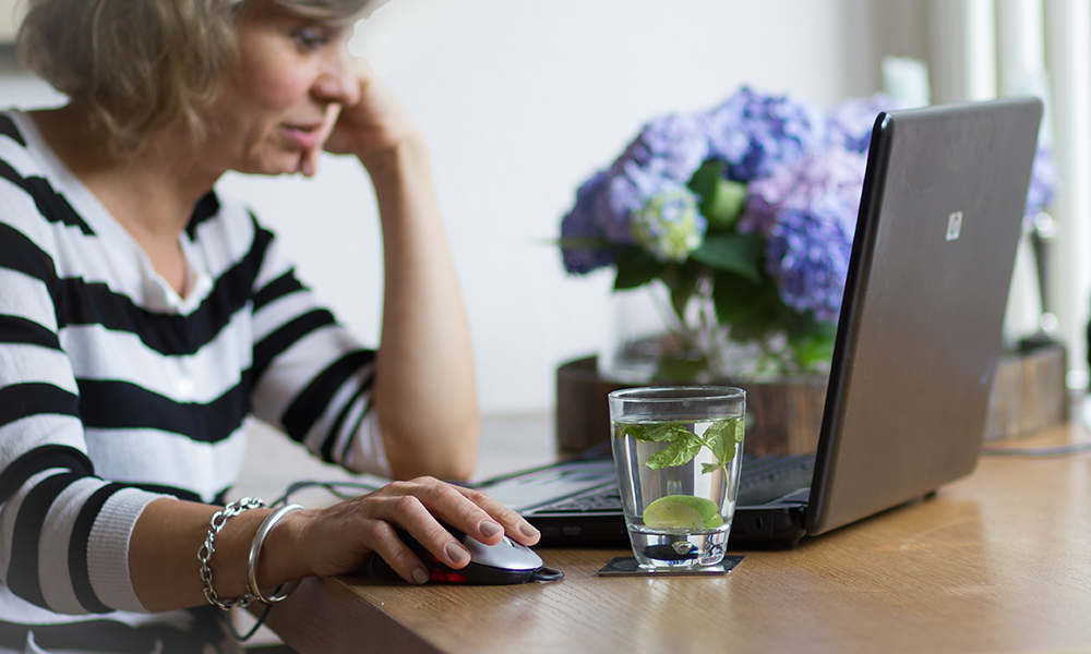 Woman undertaking self-guided online threapy