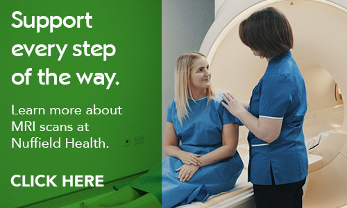 Patient is comforted by radiographer before an MRI scan. Click here to learn more about MRI scans at Nuffield Health.