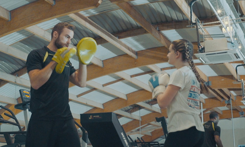 Beth Samsa boxing with personal trainer Michael Bell