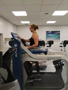 Sarah out of a wheelchair using the AlterG rehabilitation treadmill at Nuffield Health Leeds Hospital