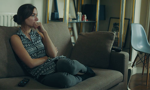 Young woman on couch s-promo