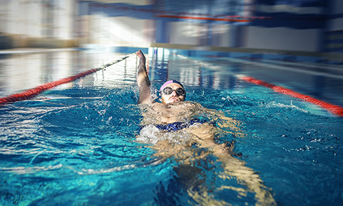 Man swimming backstroke