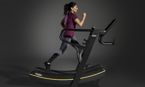 TECHNOGYM SKILLMILL - woman walking on gym equipment