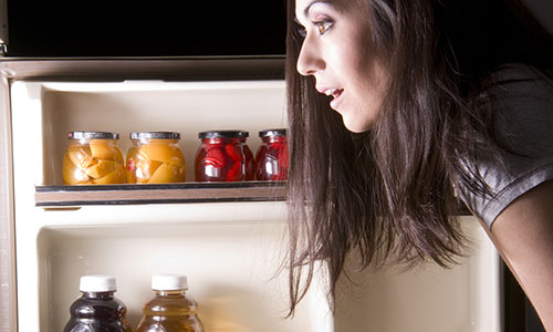 Woman raiding fridge in the middle of the night