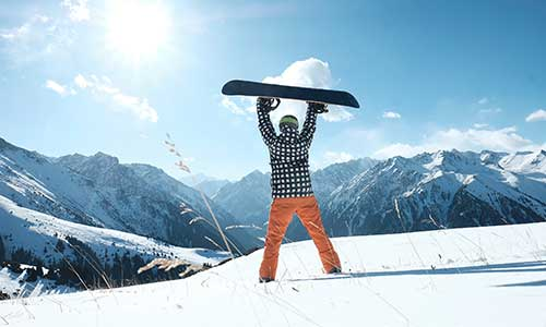 Snowboarder celebrating