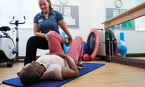 Physiotherapist supporting treatment