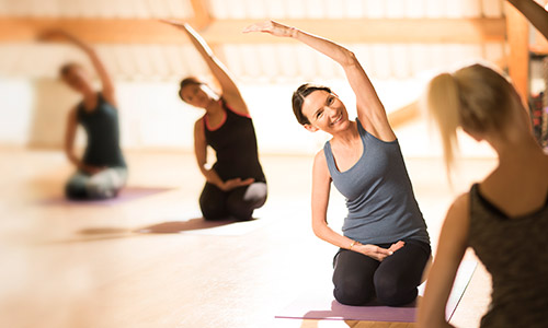 New mum doing pilates exercise after pregnancy