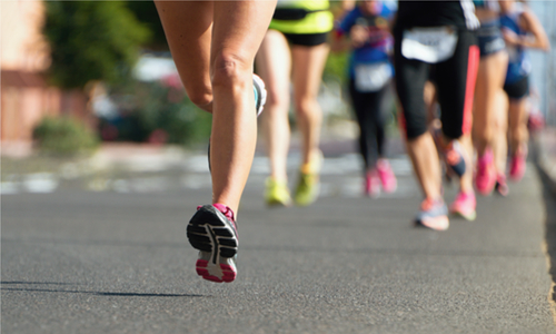 Legs of runners in a road marathon