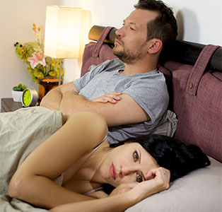 Couple unhappy in bed