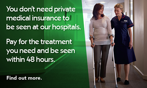 Woman on crutches being assisted by nurse in hospital hallway. Click here to find out more about paying for yourself.