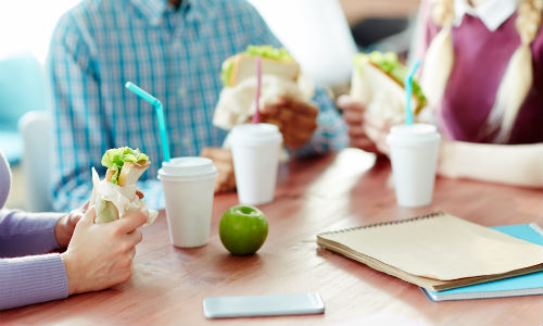Young People Eating In Canteen
