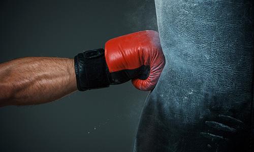Boxing glove punching punch bag