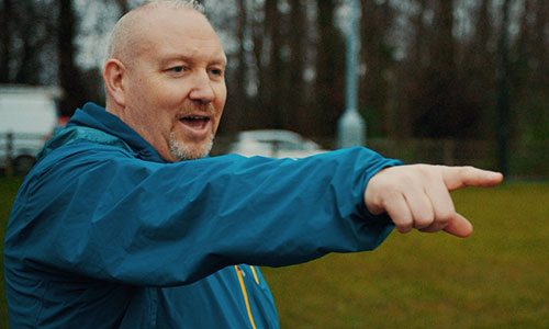 Man pointing and shouting during sports activity outdoors