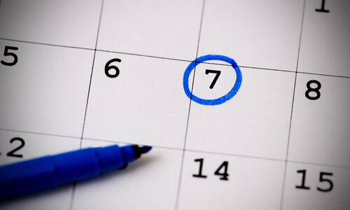 A date circled in blue pen on a calendar