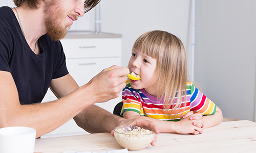Child eating porridge