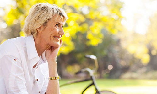 Mature woman smiling on a park bench