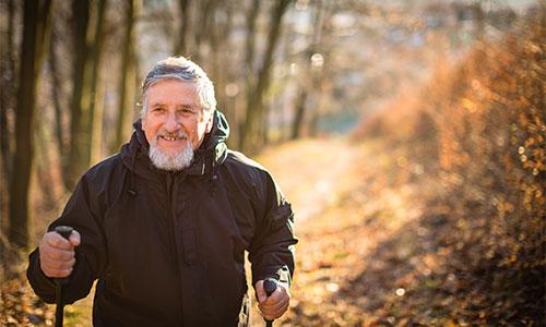 Senior man walking outdoors