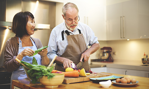 Cooking mindfully - older couple cooking in kitchen