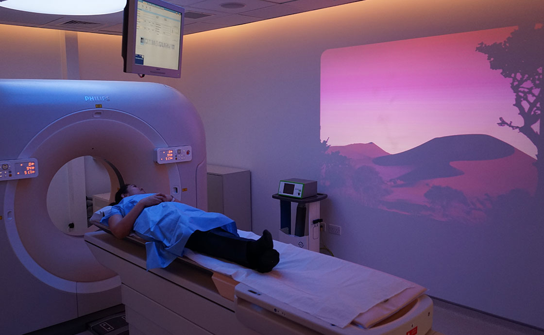 Patient in CT scan with ambient technology