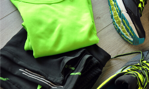 Black and green sports clothes and trainers