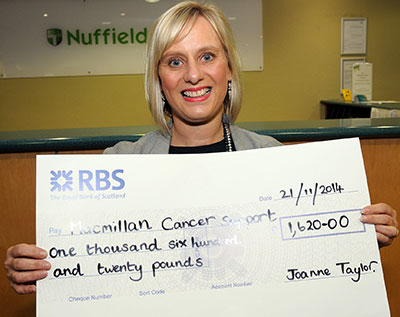 Joanne with funds raised for cancer charity