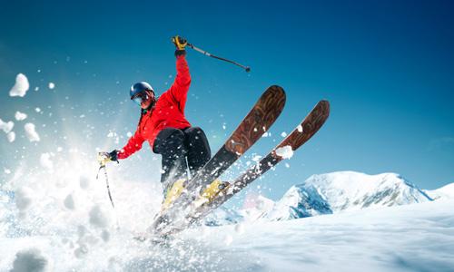 Skier falling down slope