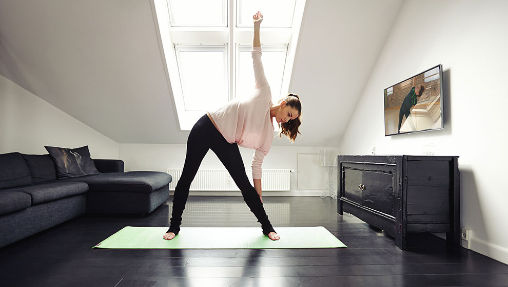 Woman doing a Nuffield Health 24/7 workout at home