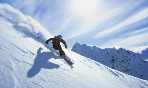 Skiier going downhill at speed