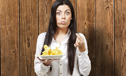 Woman eating junk food