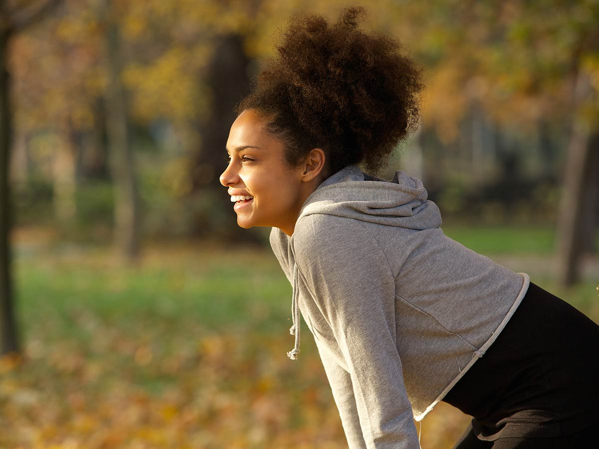 Woman smiling in park after exercise