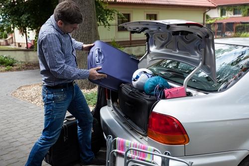 Lifting luggage into car