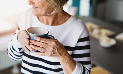 Older woman with cup of coffee