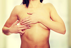 Woman checking breast